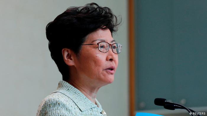 Hong Kong Chief Executive Carrie Lam holds copies of her annual policy address to journalists before a weekly Executive Council meeting in Hong Kong (REUTERS)