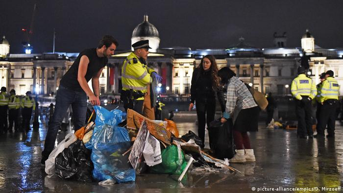 Protesters gather their belongings as police work to remove the last of the Extinction Rebellion demonstration in Trafalgar Square