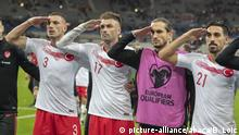 Turkish players give a military salute