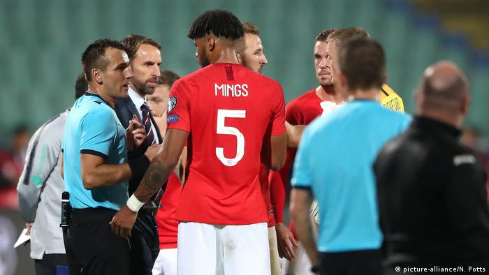 Match referee Ivan Bebek (left) speaks to England manager Gareth Southgate and Tyrone Mings about racist chanting from fans
