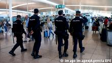 Police patrol an airport in Barcelona on October 15, the day after mass protests against the sentencing of Catalan separatist leaders (Imago Images/Agencia EFE)