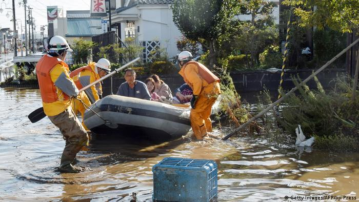 Rescuers evacuate a residents in an inflatable rescue boat.