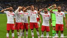 Turkish players salute at the end of the Euro 2020 Group H qualification football match between France and Turkey at the Stade de France in Saint-Denis, outside Paris on October 14, 2019. (Photo by Alain JOCARD / AFP) (Photo by ALAIN JOCARD/AFP via Getty Images)