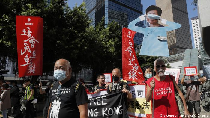 Protesters stage a rally outside the Legislative Council as Hong Kong leader Carrie Lam delivers her annual policy speech