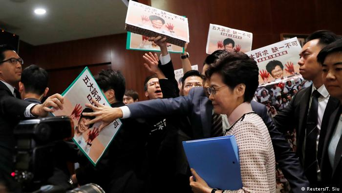 Carrie Lam arrives to address, meets protest