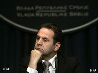 Serbian government official in charge of relations with the Hague tribunal, Rasim Ljajic, listens to a reporter's question at a press conference in Belgrade, Serbia, Thursday, June 11, 2009. Ljajic said at a press conference that the footage that appeared in Bosnian media that shows top fugitive and genocide suspect Ratko Mladic singing at parties and moving freely in Serbia was part of the material that was confiscated last year from Mladic's Belgrade home and handed over to the U.N. prosecutors and that none of the videos shown were made after 2001. (AP Photo/Marko Drobnjakovic)