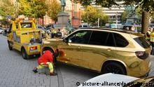 BMW X5 Gold (picture-alliance/dpa/G. Berger)