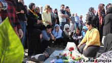 """10. Description of photo: A family at the tomb of a Kurdish fighter Title: """"Left to rot"""" Series Title in case there are several pictures about one topic: """"Syrian Kurds try to reshuffle amid new threats"""" Tags (Syria, Kurds, Funeral, Derik, Rojava)  Name of the photographer/or source Karlos Zurutuza When was the pic taken? (October, 2019)  Where was the pic taken (Derik, Syria) Description of the pic/occasion, situation when pic was taken, whom or what does the pic show? The Kurds in Syria opted to side neither with the regime nor the opposition after the civil war broke out in 2011. Eight years later they stand by themselves, besieged from almost every possible corner and with no one to back them after the American withdrawal."""