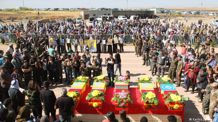 A funeral in Derik, in Syria's northeast