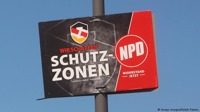 An NPD sign advertises the party's extreme-right militias.