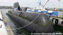 A Type 214 submarine docked at a port