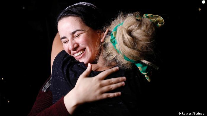 Hajar Raissouni leaves prison and hugs relatives