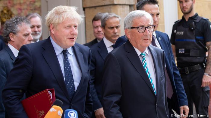Premiê britânico, Boris Johnson e presidente da Comissão Europeia, Jean-Claude Juncker