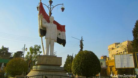 A statue of Hafez Assad presides in Qamishli