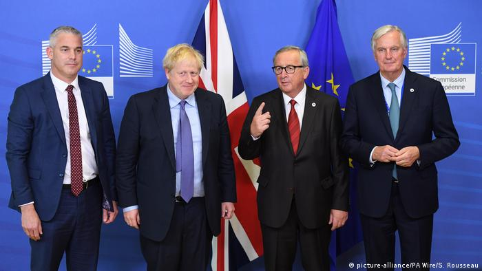 Brexit Secretary Stephen Barclay, Prime Minister Boris Johnson, Jean-Claude Juncker, President of the European Commission, and Michel Barnier, the EU's Chief Brexit Negotiator, ahead of the opening sessions of the European Council summit at EU headquarters in Brussels.