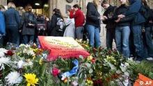 Students pass by a sea of floral tributes as they enter the city hall of Erfurt, eastern Germany, on Monday, April 29, 2002, three days after a 19-year-old former student shot 16 people before killing himself in a rampage shooting at the city's Gutenberg high school on Friday, April 26. Erfurt pupils and students were given the opportunity to sign condolence lists and to use the city's psychological help service at the city hall. (AP Photo/Michael Sohn)