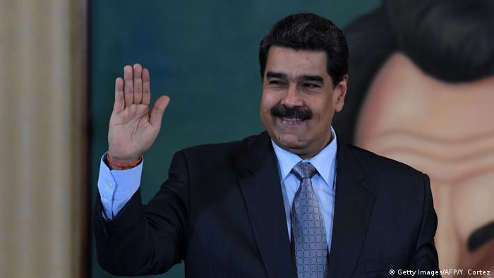 Nicolas Maduro waving