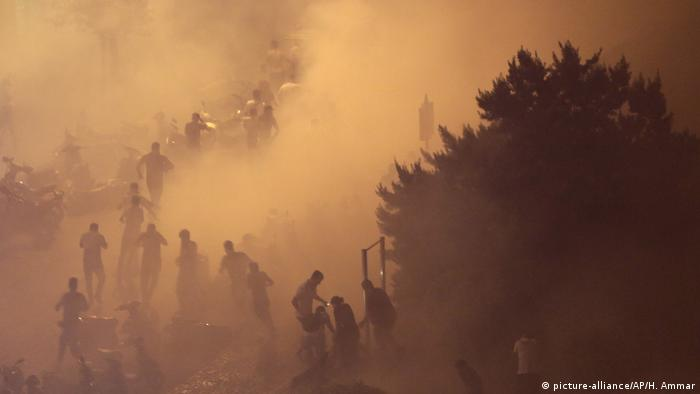 Protesters in heavy smoke