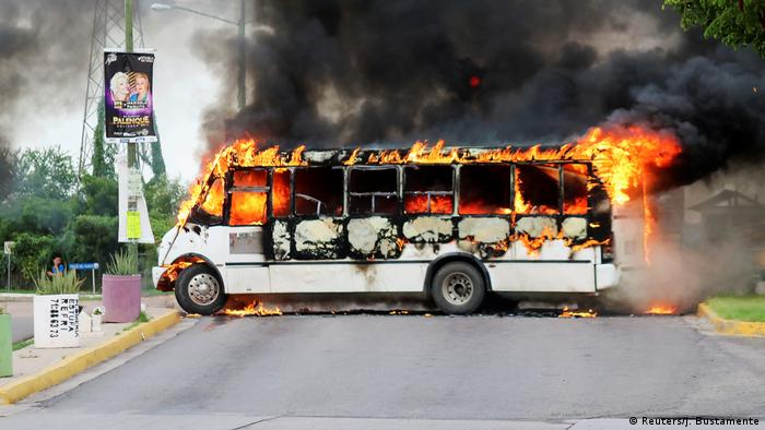 A burning bus blocks a road in Culiacan, Mexico, after being set alight by cartel members following the attempted detention of Ovidio Guzman (Reuters/J. Bustamente)
