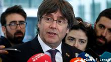 Former Catalan leader Carles Puigdemont talks to the media as he leaves free a prosecutor office at the Justice Palace after handing himself to police in Brussels, Belgium October 18, 2019. REUTERS/Francois Lenoir