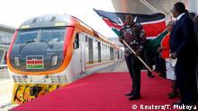 Kenya's President Uhuru Kenyatta flags off the train linking Nairobi and Naivasha at the Nairobi Terminus operating the Standard Gauge Railway (SGR) line constructed by the China Road and Bridge Corporation (CRBC) and financed by Chinese government in the outskirts of Nairobi, Kenya October 16, 2019. REUTERS/Thomas Mukoya