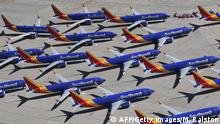 TOPSHOT - Southwest Airlines Boeing 737 MAX aircraft are parked on the tarmac after being grounded, at the Southern California Logistics Airport in Victorville, California on March 28, 2019. - After two fatal crashes in five months, Boeing is trying hard -- very hard -- to present itself as unfazed by the crisis that surrounds the company. The company's sprawling factory in Renton, Washington is a hive of activity on this sunny Wednesday, March 28, 2019, during a tightly-managed media tour as Boeing tries to communicate confidence that it has nothing to hide. Boeing gathered hundreds of pilots and reporters to unveil the changes to the MCAS stall prevention system, which has been implicated in the crashes in Ethiopia and Indonesia, as part of a charm offensive to restore the company's reputation. (Photo by Mark RALSTON / AFP) (Photo credit should read MARK RALSTON/AFP/Getty Images)