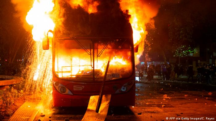 A bus set on fire during protests in Santiago, Chile