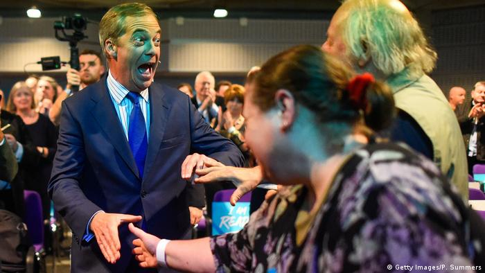 Nigel Farage arrives at a Brexit Party rally