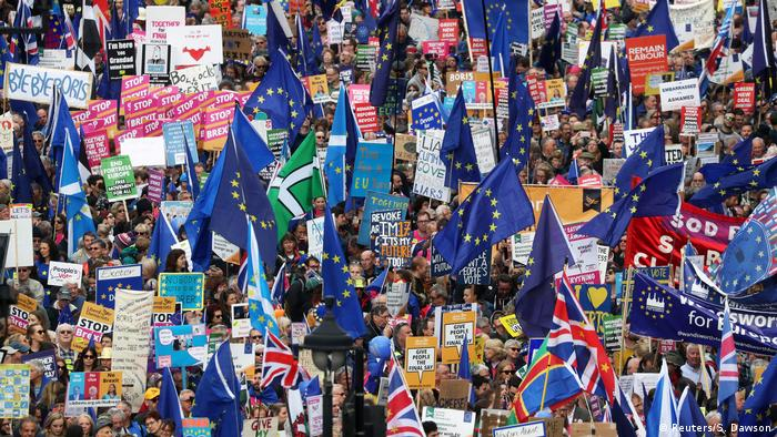 Thousands of anti-Brexit protesters waving EU flags