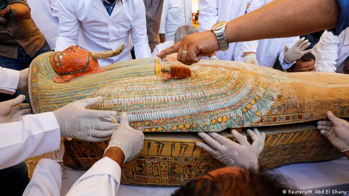 Opening of a ancient painted coffin in Luxor