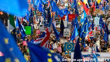 Demonstrators hold placards and EU flags as they take part in a march by the People's Vote organisation in central London on October 19, 2019, calling for a final say in a second referendum on Brexit. - Thousands of people march to parliament calling for a People's Vote, with an option to reverse Brexit as MPs hold a debate on Prime Minister Boris Johnson's Brexit deal. (Photo by Niklas HALLE'N / AFP) (Photo by NIKLAS HALLE'N/AFP via Getty Images)