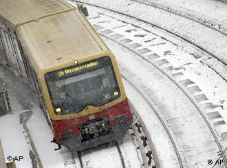 An ICE train on snowy tracks