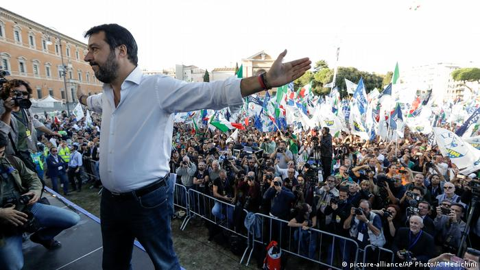 Salvini spreads his arms in front of a crowd in Rome