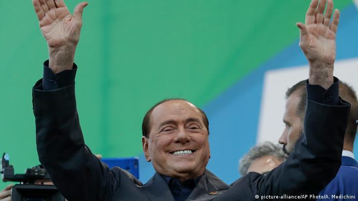 Silvio Berlusconi greets the crowd in Rome