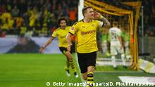 DORTMUND, GERMANY - OCTOBER 19: Marco Reus of Borussia Dortmund celebrates after scoring his team's first goal during the Bundesliga match between Borussia Dortmund and Borussia Moenchengladbach at Signal Iduna Park on October 19, 2019 in Dortmund, Germany. (Photo by Dean Mouhtaropoulos/Bongarts/Getty Images)