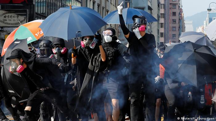 Protesters in Hong Kong with umbrellas