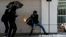 20.10.2019 *** An anti-government demonstrator throws a petrol bomb during a protest march in Hong Kong, China, October 20, 2019. REUTERS/Kim Kyung-Hoon