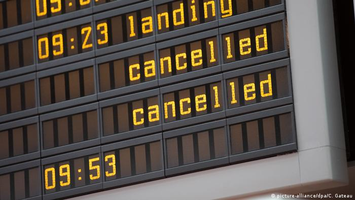 An arrivals board at Berlin's Tegel airport lists cancelled flights
