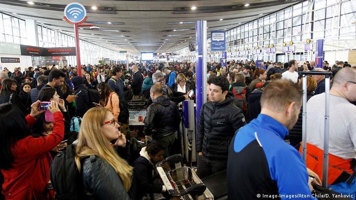 Passengers crowd the terminal at Santiago Airport
