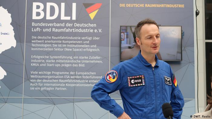 German astronaut Matthias Maurer answering question from the public at a meeting in Berlin of space businesses