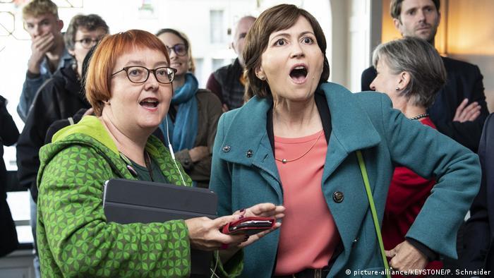 Greens president Regula Rytz (right) and Natalie Imboden react to vote returns