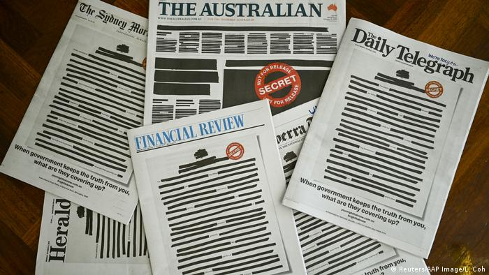 Front pages of major Australian newspapers show a 'Your right to know campaign, in Canberra, Australia, October 21, 2019. Australia's biggest newspapers ran front pages on Monday made up to appear heavily redacted to protest against recent legislation that restricts press freedoms, a rare show of unity by the usually tribal media industry. (Reuters/AAP Image/L. Coch)