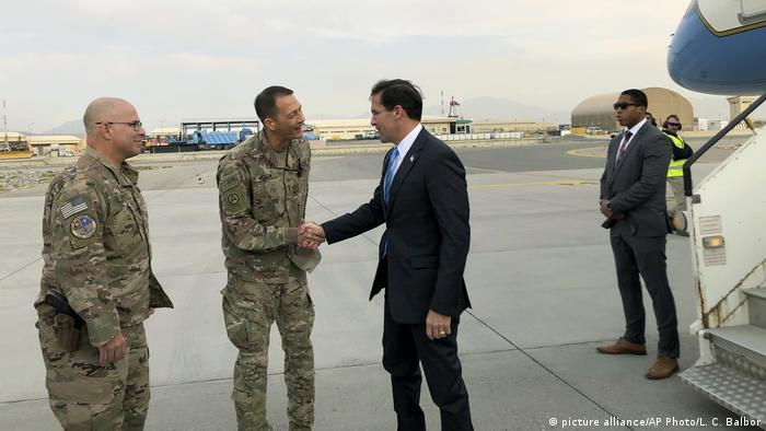 US Defense Secretary Mark Esper, center, is greeted by U.S. military personnel upon arriving in Kabul, Afghanistan, Sunday, Oct. 20, 2019.