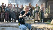 A girl holds a movie clapper board suring the during the shooting of the cossack comedy TV series Ablolutely False Story at the territory of the Historical and Cultural Complex «Zaporizhzhia Sich», Zaporizhzhia, southeastern Ukraine, August 10, 2019. Ukrinform. /VVB/ |