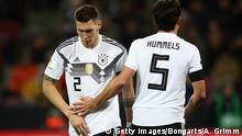 COLOGNE, GERMANY - NOVEMBER 14: Niklas Suele and Mats Hummels of Germany react during the international friendly match between Germany and France at RheinEnergieStadion on November 14, 2017 in Cologne, Germany. (Photo by Alex Grimm/Bongarts/Getty Images)