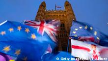 21.10.2019 EU and Union flags flutter in the breeze as Pro and anti-Brexit demonstrators protest outside of the Houses of Parliament in central London on October 21, 2019. - UK Parliament Speaker John Bercow blocked British Prime Minister Boris Johnson from holding a vote Monday on his new Brexit divorce deal after MPs failed to back it on Saturday. The motion will not be debated today as it would be repetitive and disorderly to do so, Bercow told lawmakers in the House of Commons. (Photo by Tolga AKMEN / AFP) (Photo by TOLGA AKMEN/AFP via Getty Images)