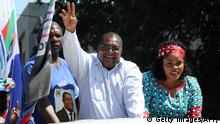 10.09.2019 Presidential candidate of the Mozambique National Resistance (Renamo), a former rebel group-turned-opposition party, Ossufo Momade (C), greets supporters from a car during his election campaign on September 10, 2019 in Marracuene, Maputo Province. - Mozambique's presidential election will be held on October 15, 2019 (Photo by - / AFP) (Photo credit should read -/AFP/Getty Images)