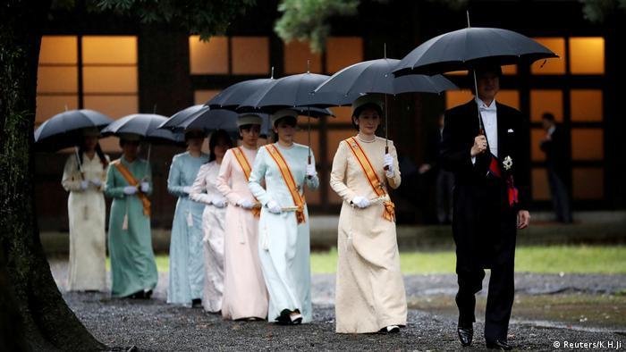 Japan's Crown Prince Akishino and Crown Princess Kiko arrive at the ceremony site