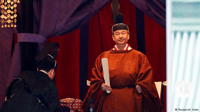 Japan's new emperor Naruhito appears at his enthronement ceremony at the imperial palace.