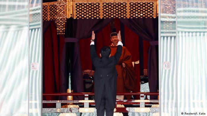 Japanese Prime Minister Shinzo Abe shouts banzai